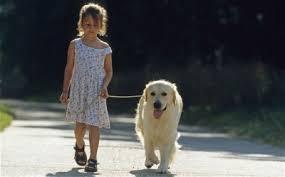 little gir and dog